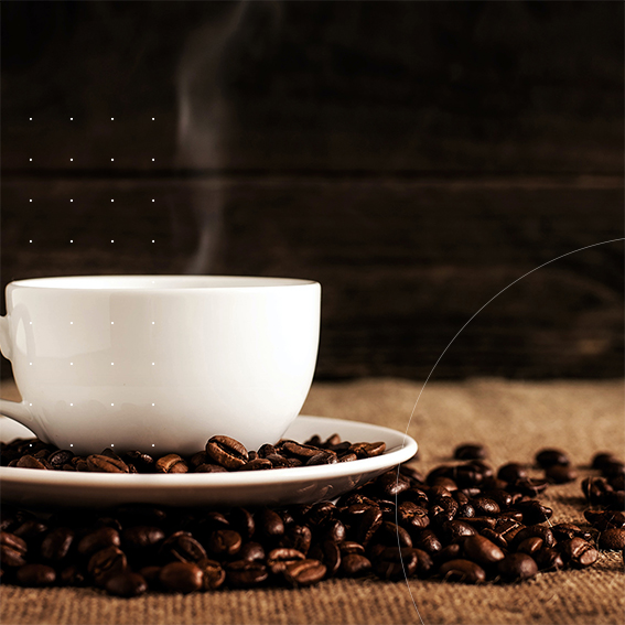 does coffee dehydrate you image coffee cup and saucer with coffee beans surrounding it