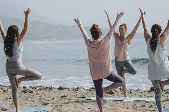 marketing fitness business images young women doing yoga on the beach