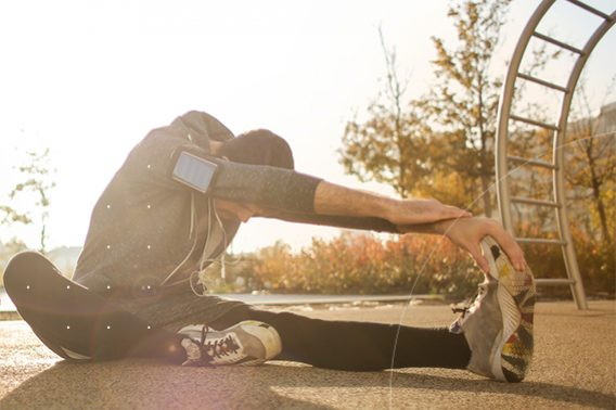 workout warm up or cool down blog, man stretching in sun