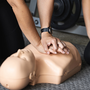 CPR Course - Trainer performing CPR on a dummy