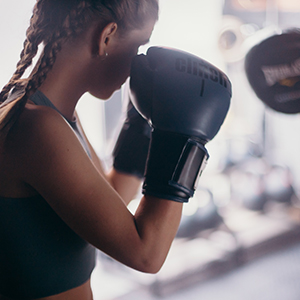 boxing for fitness - girl wearing boxing gloves in the on guard position